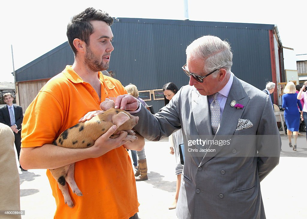 Prince Charles, Prince of Wales is shown a piglet as he visits Humble by Nature Farm on July 9 2015 in Monmouth, Wales. Humble by Nature is a working farm which was saved from closure by Kate Humble and her husband Ludo Graham in 2010. It includes a rural skills centre as well as a farm shop, cafe and adventure playground.