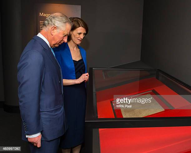 Prince Charles Prince of Wales is shown an original Magna Carta manuscript by Head of Medieval Manuscripts Clare Breay during a visit to open the...
