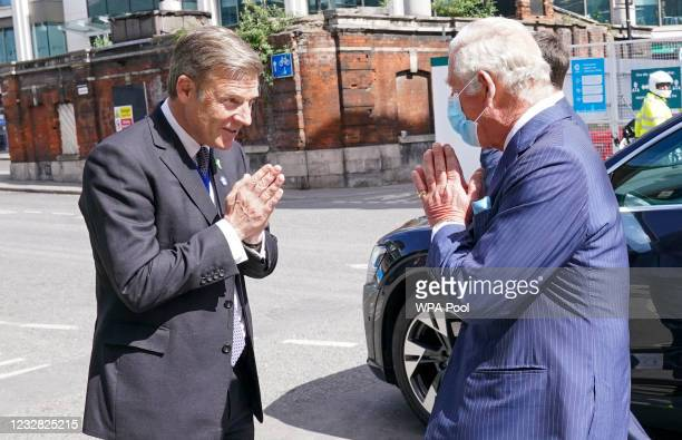 Prince Charles, Prince of Wales is welcomed by the Lord Mayor of London William Russell at Smithfield Market as he views construction and...