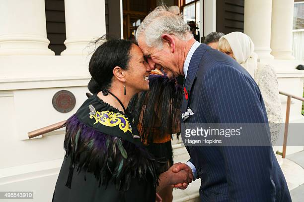 Prince Charles Prince of Wales is welcomed with a hongi from New Zealand Defence Force Flight Sergeant Wai Paenga during a welcome ceremony at...