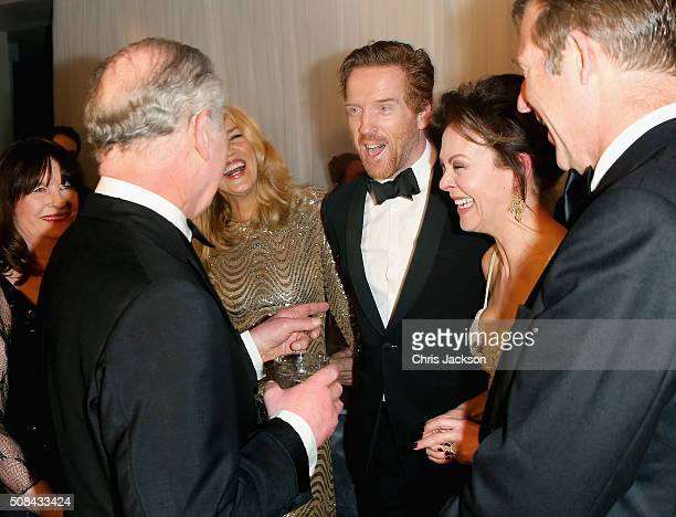 Prince Charles, Prince of Wales, Jerry Hall, Damien Lewis and Helen McCrory chat as they attend a pre-dinner reception for the Prince's Trust Invest...