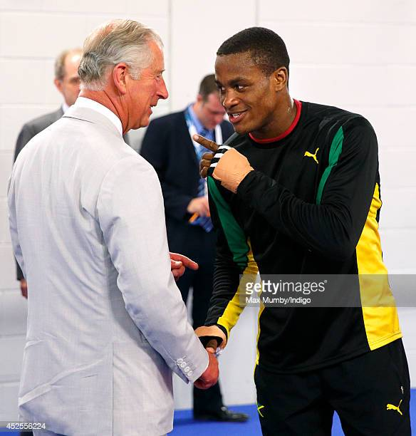 Prince Charles, Prince of Wales jokes with Jamaican boxer Cheavon Clarke as he tours the Emirates Arena and Chris Hoy Velodrome ahead of the start of...