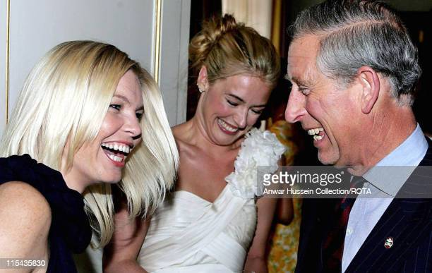 Prince Charles Prince of Wales jokes with Kate Thornton and Cat Deeley two of the presenters of The Prince's Trust 30th Birthday Live at a Clarence...