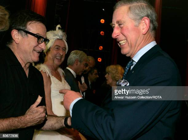 Prince Charles Prince of Wales jokes with US actor Robin Williams backstage at the Wimbledon Theatre after a charity performance in aid of the...