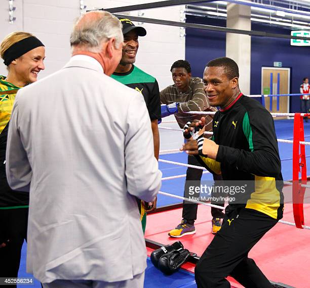 Prince Charles, Prince of Wales jokingly spas with Jamaican boxer Cheavon Clarke as he tours the Emirates Arena and Chris Hoy Velodrome ahead of the...