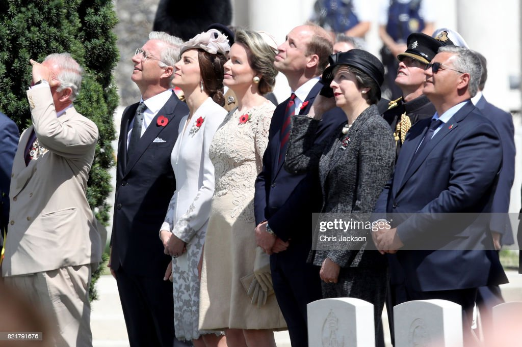 Prince Charles, Prince of Wales, King Philippe of Belgium, Catherine, Duchess of Cambridge, Queen Mathilde of Belgium, Prince William, Duke of Cambridge, Prime Minister Theresa May and Belgian Minister of Defence Steven Vandeput watch a fly past by the Belgian Air Force, who will fly in a formation known as 'The Salute to the Missing Man' during a ceremony at the Commonwealth War Graves Commisions's Tyne Cot Cemetery on July 31, 2017 in Ypres, Belgium. The commemorations mark the centenary of Passchendaele - The Third Battle of Ypres.