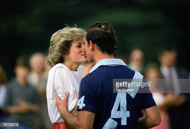 Prince Charles, Prince of Wales kisses Diana, Princess of Wales after she presents him with a prize at polo in Cirencester