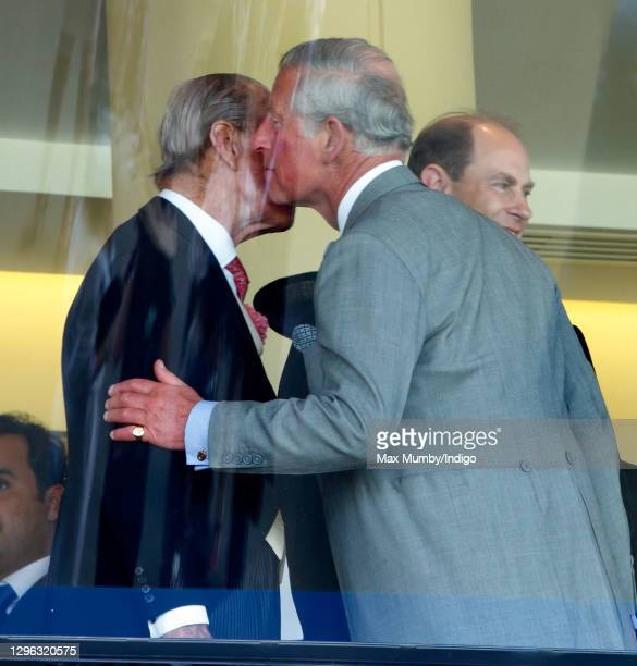 Prince Charles, Prince of Wales kisses his father Prince Philip, Duke of Edinburgh as they attend Day 2 of Royal Ascot at Ascot Racecourse on June...