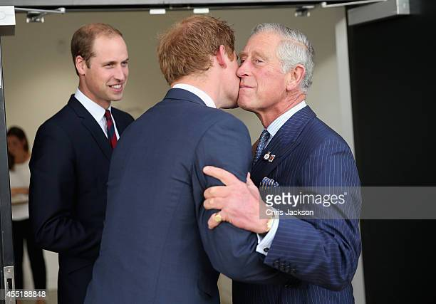 Prince Charles, Prince of Wales kisses his son Prince Harry as Prince William, Duke of Cambridge looks on ahead of the Invictus Games Opening...