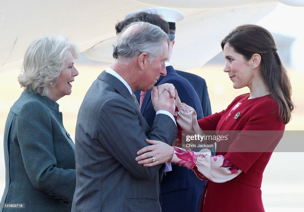Prince Charles, Prince of Wales kisses Princess Mary of Denmark's hand as he arrives at Copenhagen Kastrup Airport on March 24, 2012 in Copenhagen, Denmark. Prince Charles, Prince of Wales and Camilla, Duchess of Cornwall are on a Diamond Jubilee tour of Scandinavia that takes in Norway, Sweden and Denmark.