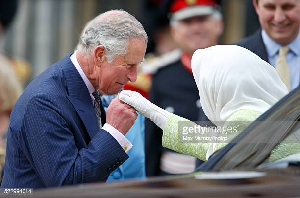 Prince Charles, Prince of Wales kisses Queen Elizabeth II's hand as they attend a beacon lighting ceremony to celebrate her 90th birthday on April...