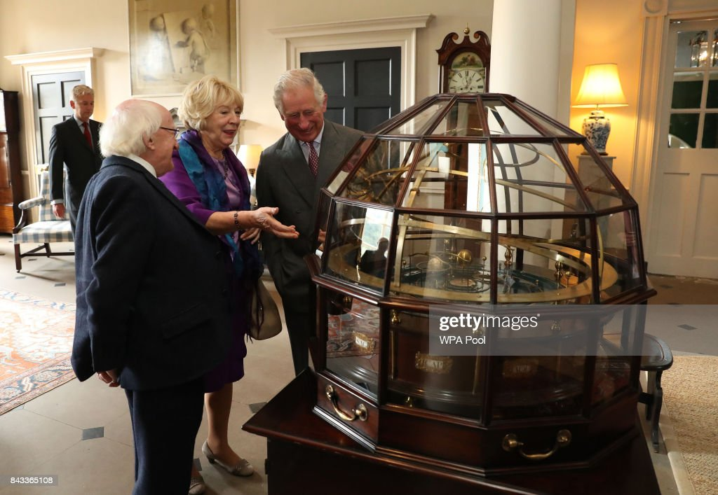 Prince Charles, Prince of Wales, known as the Duke of Rothesay in Scotland, President of Ireland Michael D Higgins and his wife Sabina Coyne view the Grand Orrery, an 18th century mechanical model of the solar system,at Dumfries House on September 6, 2017 in Cumnock, Scotland.