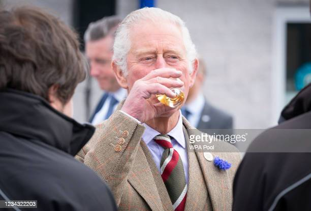 Prince Charles, Prince of Wales, known as the Duke of Rothesay when in Scotland, has a dram of whisky before officially opening the Lerwick Harbour...