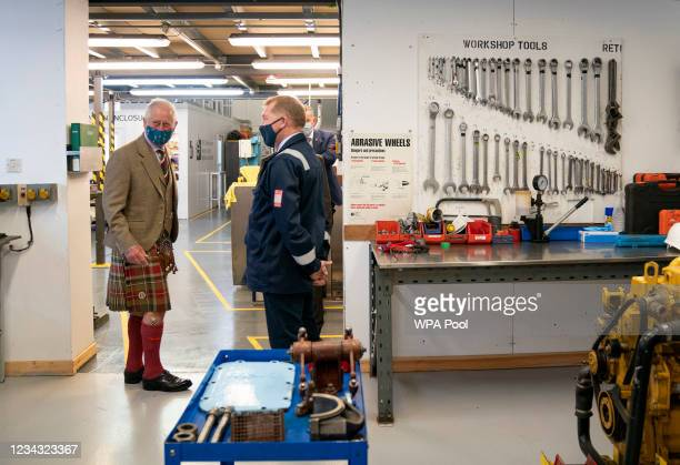 Prince Charles, Prince of Wales, known as the Duke of Rothesay when in Scotland, takes a look inside the marine engine workshop during a visit to the...