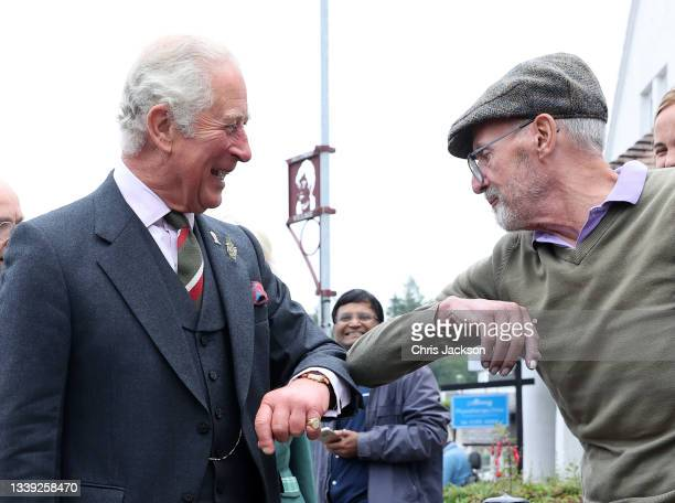 Prince Charles, Prince of Wales known as the Duke of Rothesay when in Scotland, visits Alloway Main Street and greats the crowd on September 09, 2021...