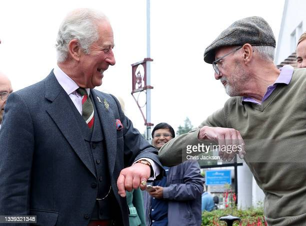 Prince Charles, Prince of Wales known as the Duke of Rothesay when in Scotland, meets members of the public as he visits Alloway main street on...