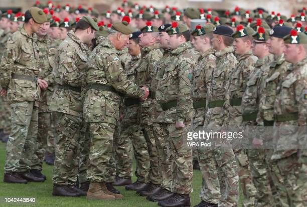 Prince Charles, Prince of Wales, known as the Duke of Rothesay whilst in Scotland, presents Iraq campaign medals to soldiers from The Black Watch,...