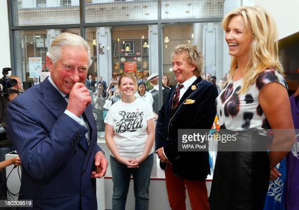Prince Charles Prince of Wales laughs as he chats with Penny Lancaster watched by Rod Stewart during the opening of The Prince's trust 'Tomorrow's...