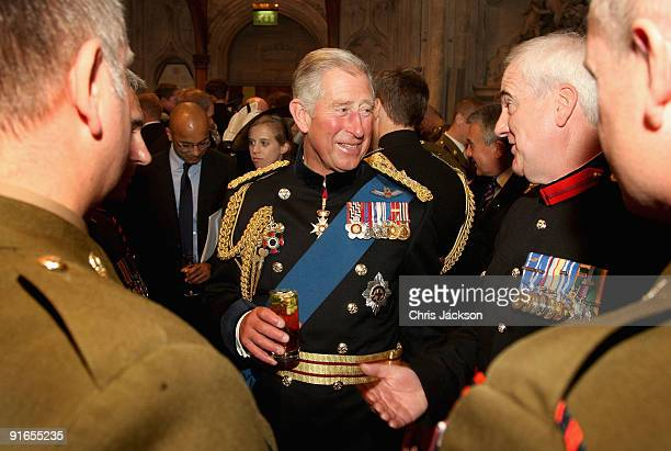 Prince Charles, Prince of Wales laughs as he chats with soldiers during a reception at London Guildhall after a Service of Commemoration to mark the...