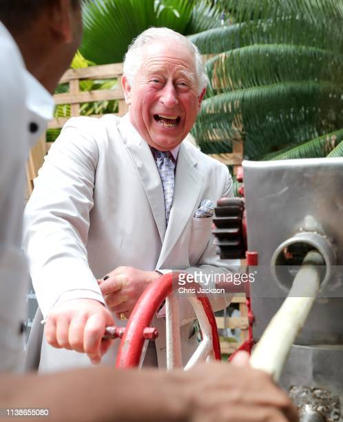Prince Charles, Prince of Wales laughs as he grinds sugar cane during a visit to a paladar called Habanera, a privately owned restaurant on March 27,...