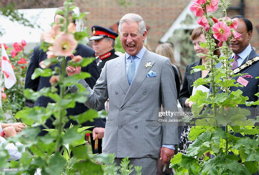 Prince Charles, Prince of Wales laughs as he is taken on a tour of St Pancras Almshouses on July 8, 2009 in London, England. The Prince of Wales, patron of The Almshouse Association, presented the Patron's Awards and met residents and community leaders to celebrate the 150th anniversary of the Almshouses.