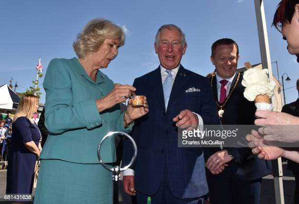 Prince Charles Prince of Wales laughs as he refuses the offer of a large ice cream cone in front of a large group of photographers as he and Camilla...