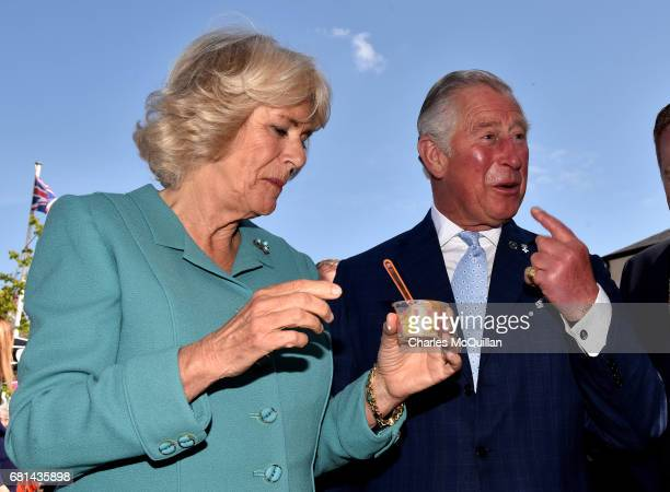 Prince Charles Prince of Wales laughs as he refuses the offer of a large ice cream cone in front of a group of photographers as he and Camilla...
