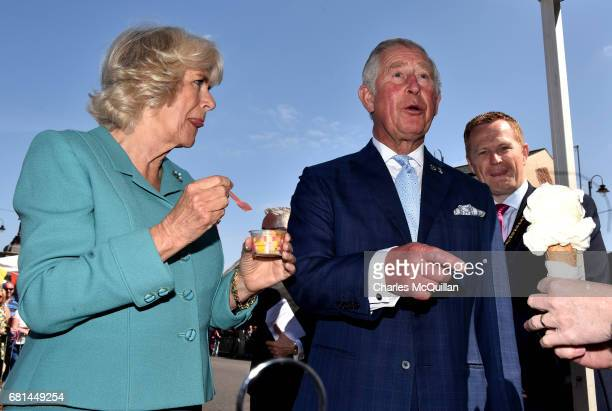 Prince Charles Prince of Wales laughs as he refuses the offer of a large ice cream cone in front of a group of photographers as he and the Duchess of...