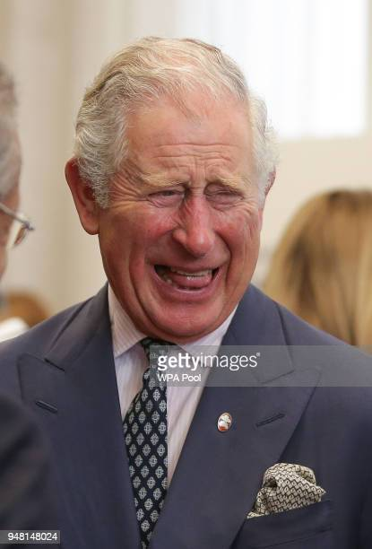 Prince Charles Prince of Wales laughs as he talks with guests at a reception at the closing session of the Commonwealth Business Forum at the...