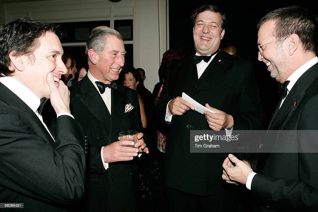 HRH Prince Charles, Prince of Wales laughs with Eric Clapton, Stephen Fry and Jules Holland during a gala at the Banqueting House as a fundraiser in aid of the Prince's Trust Charity on November 23, 2005 in London.