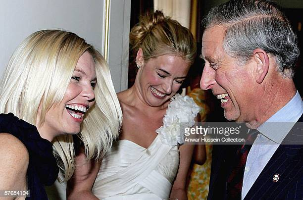 Prince Charles Prince of Wales laughs with TV presenters Kate Thornton and Cat Deeley during a reception at Clarence House prior to The Prince's...