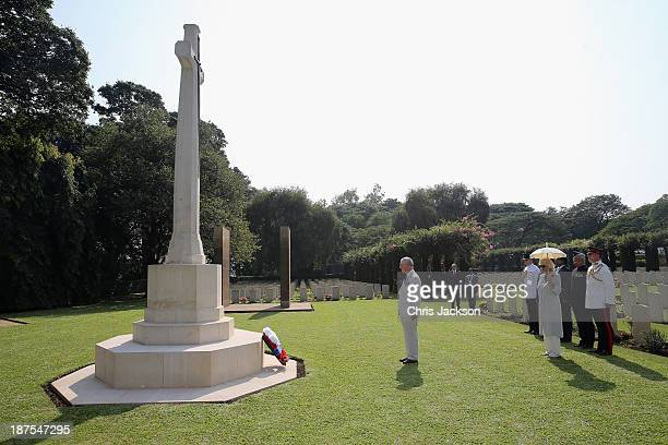 Prince Charles, Prince of Wales lays a wreath at Kirkee Commonwealth Cemetary on Day 5 of an official visit to India on November 10, 2013 in Pune,...