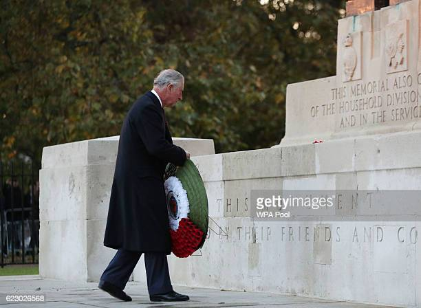 Prince Charles Prince of Wales lays a wreath at the Guard's Memorial for the Welsh Guards' Regimental Remembrance Sunday on Horse Guards Road on...
