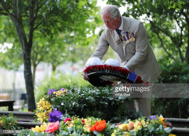 Prince Charles Prince of Wales lays a wreath at the VJ Day National Remembrance event held at the National Memorial Arboretum in Staffordshire on...