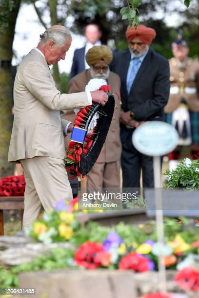 Prince Charles Prince of Wales lays a wreath during a national service of remembrance marking the 75th Anniversary of VJ Day at The National Memorial...