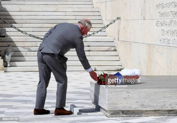 Prince Charles Prince of Wales lays a wreath during a visit to the Tomb of the Unknown Soldier on May 9 2018 in Athens Greece Prince Charles Prince...