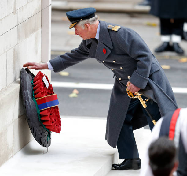 Prince Charles Prince of Wales lays a wreath on behalf of Queen Elizabeth II during the annual Remembrance Sunday Service at The Cenotaph on November...