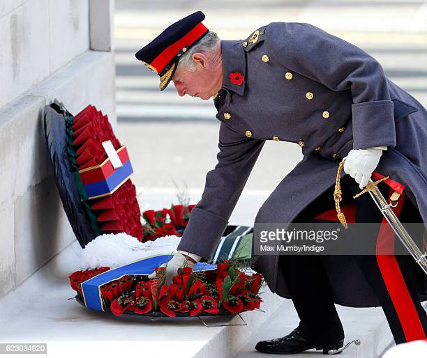 Prince Charles Prince of Wales lays his wreath as he attends the annual Remembrance Sunday Service at the Cenotaph on Whitehall on November 13 2016...
