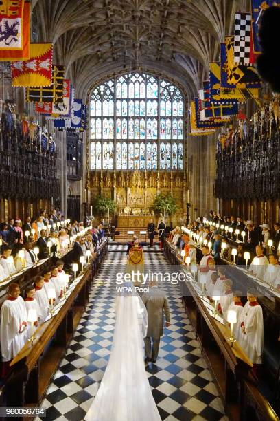 Prince Charles Prince of Wales leads Meghan Markle up the aisle during her wedding in St George's Chapel at Windsor Castle on May 19 2018 in Windsor...