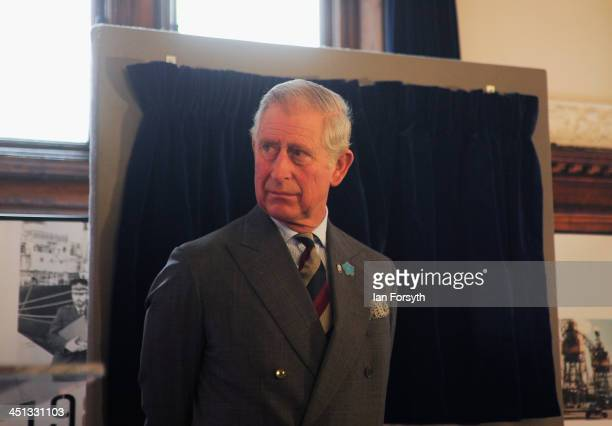 Prince Charles Prince of Wales listens to a speech by David Robinson the CEO of PD Ports as he visits their offices to mark the 50th anniversary of...