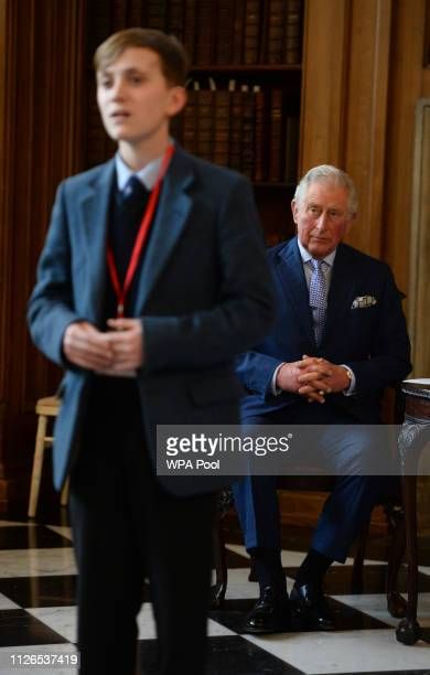 Prince Charles Prince of Wales listens to senior winner Joseph Oxtoby during a visit to Lambeth Palace to present the Cranmer Awards at the Prayer...
