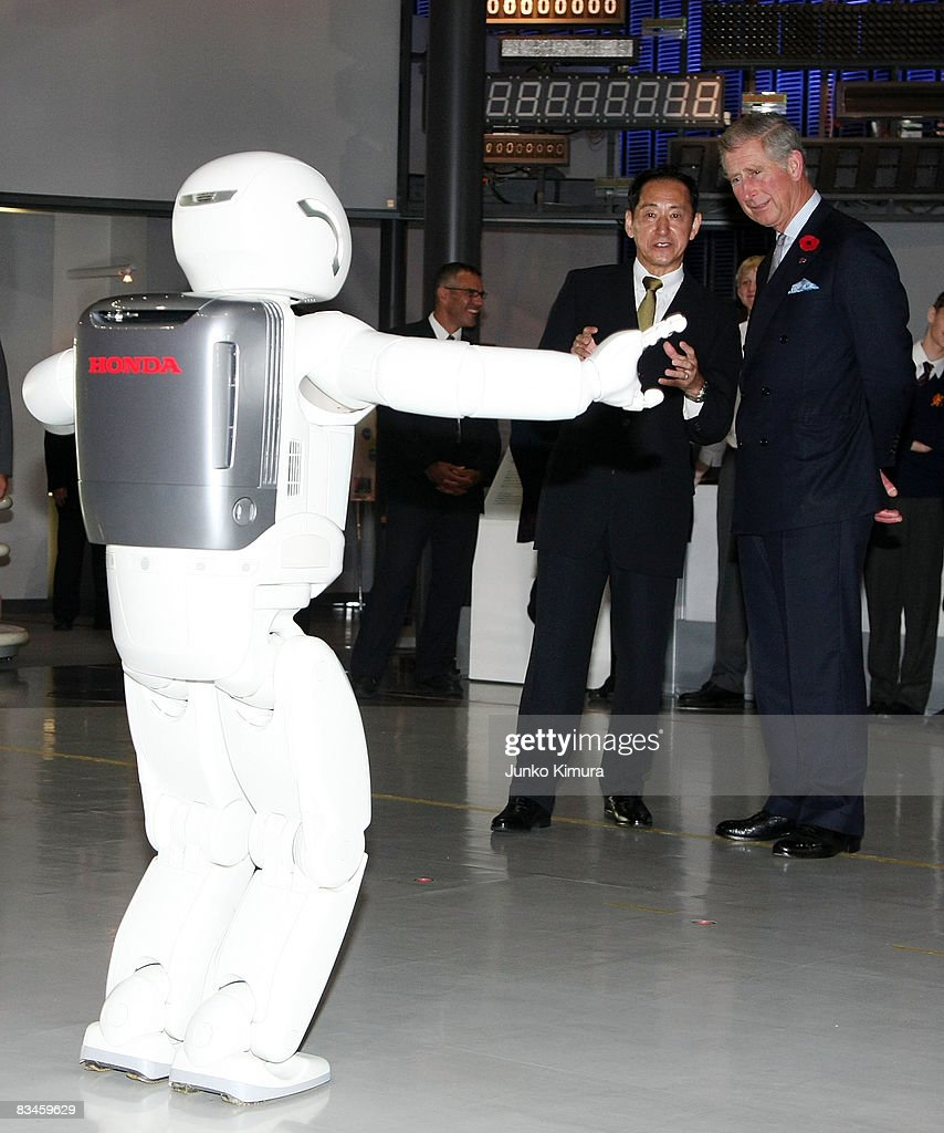 Prince Charles, Prince of Wales (R) looks at Honda's humanoid robot 'Asimo' at the National Museum Of Emerging Science And Innovation (Miraikan Museum) on October 28, 2008 in Tokyo, Japan. The Prince and the Duchess are in Japan to celebrate the 150th anniversary of diplomatic relations with the United Kingdom.