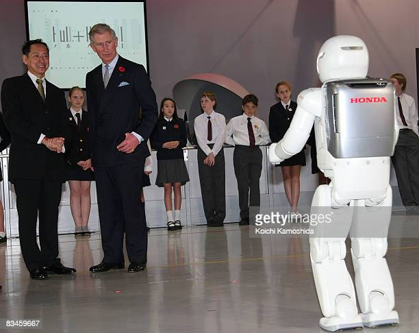 Prince Charles Prince of Wales looks at Honda's humanoid robot 'Asimo' at the National Museum of Emerging Science and Innovation on October 28 2008...