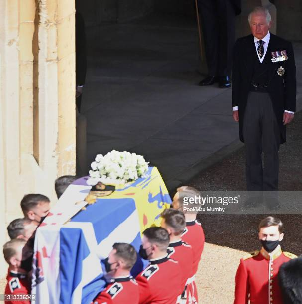 Prince Charles, Prince of Wales looks on as a Bearer Party of Grenadier Guards carry Prince Philip, Duke of Edinburgh's coffin out of the State...