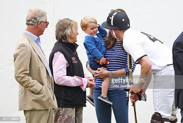 Prince Charles Prince of Wales looks on as his son talks to Prince George of Cambridge and Catherine Duchess of Cambridge as they attend the Gigaset...