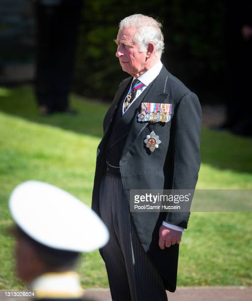 Prince Charles, Prince of Wales looks on as the coffin of Prince Philip, Duke of Edinburgh arrives St George's Chapel in a purpose build Land Rover...