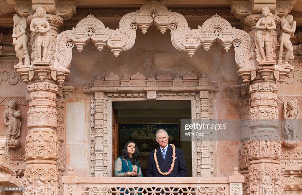 Prince Charles, Prince Of Wales looks out at the gardens with Arshana Sanghrajka an expert in Jain Temple Architecture during a tour of the Jain Temple on January 22, 2015 in Potters Bar, Hertfordshire, England. The Prince Of Wales was later presented with the Ahimsa Award which recognises individuals who show compassion and tolerance to humanity, animals and the environment.