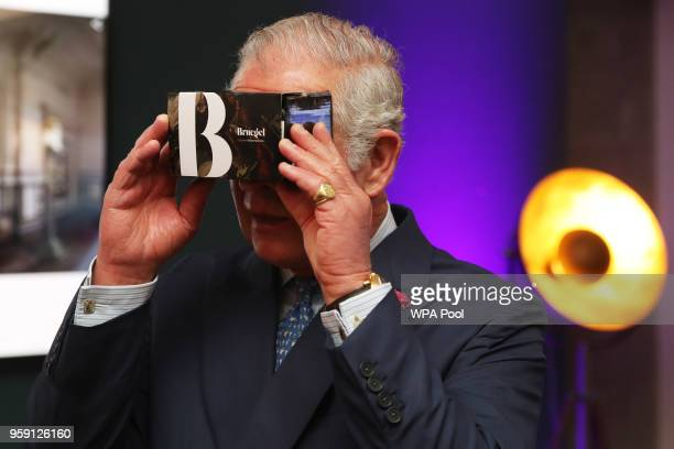 Prince Charles, Prince of Wales looks through a virtual reality viewer during a visit to the YouTube Space London at Kings Cross on May 16, 2018 in...