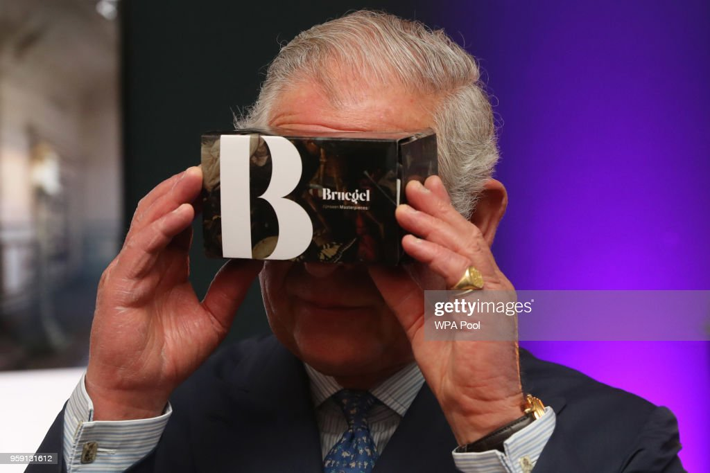 Prince Charles, Prince of Wales looks through a virtual reality viewer during a visit to the YouTube Space London at Kings Cross on May 16, 2018 in London England. Prince Charles, Prince of Wales and Camilla, Duchess of Cornwall are making a whistle stop tour of the capital, visiting businesses showcasing innovation.