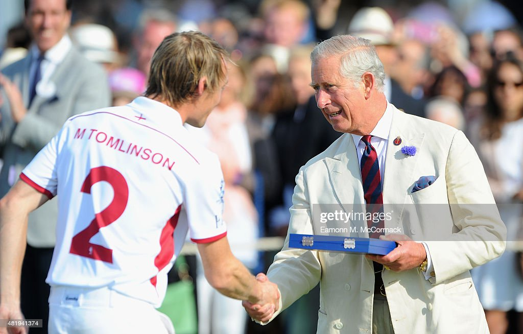 Prince Charles, Prince of Wales makes the presentations at the Royal Salute Coronation Cup at Guards Polo Club on July 25, 2015 in Egham, England.
